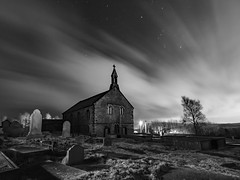 St Thomas' Church, Friarmere or also known as the Heights Chapel, Delph. b&w (Craig Hannah) Tags: stthomaschurch heighschapel heights theheights delph friarmere saddleworth pennine church gravestones graveyard building grade2listed longexposure night nightsky stars clouds trees amonstercalls film filmset location craighannah february 2017 westriding yorkshire oldham countryside outdoors mysterious spooky greatermanchester england canon photography ghostly lightpainting