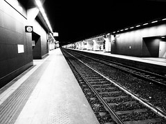 Tunnel of loneliness IV (VauGio) Tags: olympus tough4 biancoenero blackandwhite stazionediportasusa torino railwaystation turin italia italy binari treno treni trains train
