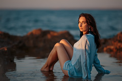 Elvira (mikhailkorzhalov) Tags: canon 6d canon135mmf2lusm 135mm f20 sevastopol crimea sea blue naturallight outdoors water rocks stones posing sitting sunset sunsetlight girl model lady young adult adultsonly pretty cute cutegirl legs longhair seascape shirt jacket