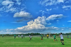 Soccer under the clouds (Pejasar) Tags: blue sky clouds dramatic boys soccer