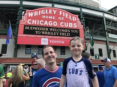 "Paul and Derek Under the Wrigley Marquee • <a style=""font-size:0.8em;"" href=""http://www.flickr.com/photos/109120354@N07/48817002951/"" target=""_blank"">View on Flickr</a>"