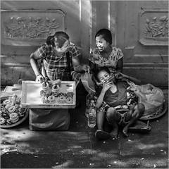 Thai smile (John Riper) Tags: johnriper street photography straatfotografie square vierkant bw black white zwartwit mono monochrome candid john riper xt3 fujifilm bangkok thailand sales women smile fun laugh girls flowers chain