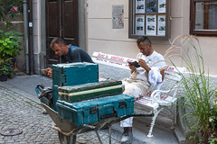 Day's Work Done (armct) Tags: downtown workers tired waiting pickup telephone mobile cellular communication sitting tools wheelbarrow packed tidy dirty sweaty men brothers workboots clothes seat renovation cobblestones pose composition isolation alike siblings street candid snapshot ljubljana slovenia