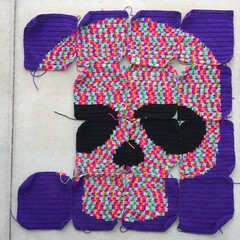 The Day of the Dead yarn bomb with variegated yarn skull A (crochetbug13) Tags: crochet crocheted crocheting crochetyarnbomb crochetdayofthedeadyarnbomb dayofthedead yarnbomb crochetflower