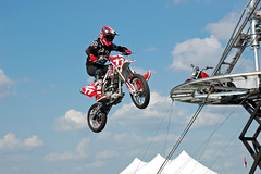 Jumping Motorcycle. (dccradio) Tags: lumberton nc northcarolina robesoncounty outdoor outdoors outside motorcycle jump jumping airtime tent canvas bike sky bluesky dirtbike clouds prop fair festival robesoncountyfair robesonregionalagriculturalfair communityevent sideshow johnnyrocketscyclecircus cyclecircuslive helmet nikon d40 dslr september fall autumn sunday weekend sundayafternoon afternoon goodafternoon photooftheday photo365 project365