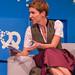 Bits & Pretzels Editor-in-Chief Britta Weddeling im Dirndl auf der Gründermesse-Hauptbühne