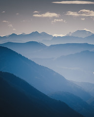 Layers (der_peste (on/off)) Tags: layers layeredlandscape mountains peaks summits alps bavaria clouds blue haze haziness