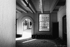 All White (Alfred Grupstra) Tags: blackandwhite architecture window nopeople builtstructure old spooky corridor door abandoned empty wallbuildingfeature indoors dark urbanscene buildingexterior house street monochrome vanishingpoint softmachine