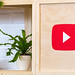 YouTube-Logo printed on a wooden board