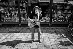 THE STREET MUSICIAN (NorbertPeter) Tags: street man spontaneous outdoor people sony rx100 music cologne köln germany streetphotography streetportrait portrait monochrome hat guitar bw blackandwhite streetartist streetmusician beard