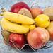 Basket with Bananas Apples Kiwi and Lemon