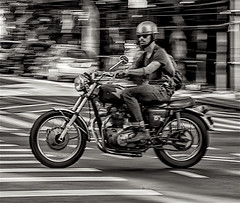 Panning of Biker Moving Along 7th Avenue Manhattan (nrhodesphotos(the_eye_of_the_moment)) Tags: dsc74313001084 wwwflickrcomphotostheeyeofthemoment theeyeofthemoment21gmailcom blackandwhite candid streetscene outdoors motorcycle biker wheels panning motion chrome helmet bike nyc manhattan metal