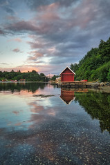 Røyksund, Norway (Vest der ute) Tags: g7x norway rogaland røyksund sea seascape landscape clouds sky reflections boathouse trees houses fav25 fav200