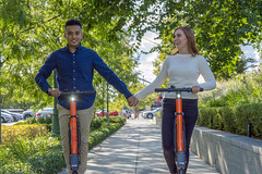 Electric Scooters in Downtown Provo (aaronrhawkins) Tags: scooters electric downtown provo utah sidewalk couple engagement fiance carlos aunica ride holdhands young collegeaged recreation rent balance aaronhawkins