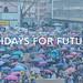 Weltweite Klimastreik-Bewegung demonstriert bei Wind und Wetter mit Regenschirmen in Großstädten, mit dem Text