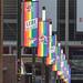 Gehisste Regenbogenfahnen vor dem Rheinenergie-Stadion und dem Text: Diversity Spieltag Köln 2019