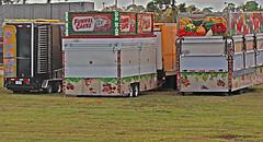Food Joints, James Strates Shows Winter Quarters, Taft, Florida (2 of 2) (gg1electrice60) Tags: jamesestratesshows strateswinterquarters stratesheadquarters 10600southorangeavenue 10600sorangeave orangecounty orlando taft florida fl unitedstates usa us america csxrailroad csxtracks csx csxt carnivalsthattravelbytrain carnivalsthattravelbytruck carnivalsthattravelbyrail floridacentralrailroad floridacentralrailway floridacentralrwy fcen shortline trackagerights carnivalrides stratesshows winterquarters carnivaltrain carnivaltrainheadquarters railcars flatcars rollingstock canon40d canoneos40d train railroadyard rearview trailers funnelcakes colddrinks severaltrailers fourtrailers pizza artwork murals advertising fruitsvegatablepictorials