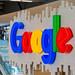 Large illuminated Google logo in a hall