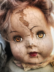 Skin Deep (drei88) Tags: image beauty forlorn torn grim sad life death metaphor searching witness doll toy childhood racing lifetime struggle cycle legacy castoff gaze glamour moment