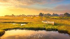 Brancaster Staithe Sunrise (Aron Radford Photography) Tags: yellow brancaster staithe north norfolk coast sea low tide sunrise dawn abandoned boat landscape seascape salt marshes