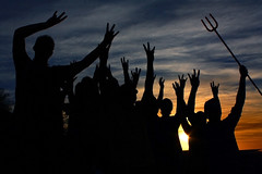 101104-group-pitchforks-at-sunset (interplanetaryinitiative) Tags: brandphotos iconicbrandphotos sunset silhouette pitchfork forksup group crowd students