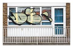 The Built Environment, East London, England. (Joseph O'Malley64) Tags: thebuiltenvironment newtopography newtopographics manmadeenvironment manmadestructure building structure eastlondon eastend london england uk britain british greatbritain flat apartment blockofflats councilhousingestate housingestate councilestate estate demolition soontobedemolished urban urbanlandscape housing homes dwellings abodes architecture architecturalfeatures architecturalphotography documentaryphotography britishdocumentaryphotography steelreinforcedconcretestructure concrete brickwork bricksmortar cement pointing doubleglazedwindows doubleglazeddoor upvcdoubleglazing door doorway entrance exit patio steelsecuritypanelling curtain railings steelrailings graffiti tagged fujix fujix100t accuracyprecision
