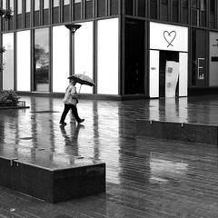 On the reflections (pascalcolin1) Tags: paris13 femme woman pluie rain reflets reflection lumière light parapluie umbrella photoderue streetview urbanarte noiretblanc blackandwhite photopascalcolin 50mm canon50mm canon