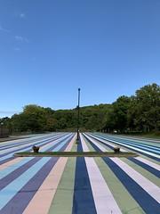 Parking lot (In Explore) (remiklitsch) Tags: flowerpot lamppost explore leadinglines iphone phonography green purple pink streetart blue parkart artpark newyork lewiston remiklitsch stripes island parkinglot