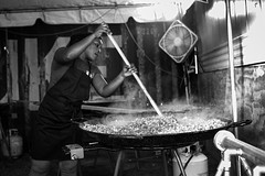 """""""Feed"""", 2019 : A volunteer chef with World Central Kitchen cooks food for more than 3100 survivors of hurricane Dorian on Abaco, Bahamas. (maurice.masdeu) Tags: photojournalism naturaldisaster hurricanerelief disasterrelief worldcentralkitchen leica246 monochrom blackandwhite abaco bahamas hurricanedorian documentary"""