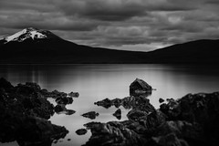 So let me in from the cold (.KiLTЯo.) Tags: kiltro cl chile magallanes tierradelfuego lagoblanco lake patagonia bw blackandwhite landscape mountain nature longexposure water rocks dark elitegalleryaoi bestcapturesaoi ao