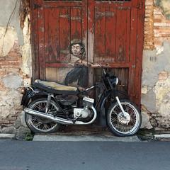 Boy On Motorcycle (peterphotographic) Tags: p7240503sqedwm boyonmotorcycle ernestzacharevic olympus em5mk2 microfourthirds mft ©peterhall georgetown penang malaysia seasia asia street streetart art installation motorbike motorcycle mural