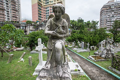 Cemetery in the City, Macau (Geraint Rowland Photography) Tags: religion portugese relics old church churchgrounds catholic christian graves gravestone cemetery eerie stone angel urban buildings wowmacao macao asia chinese colonialism eroded development wwwgeraintrowlandcouk cross religiouscross visitmacau portugesecolony canon travel