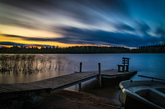 The bench (mabuli90) Tags: finland lake water boat longexposure dock bench wood sunset sky clouds autumn night forest tree beach sand nature landscape suomi