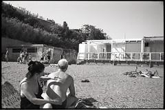 (Scratch My Back) (Robbie McIntosh) Tags: leicam2 leica m2 rangefinder streetphotography 35mm film pellicola analog analogue negative leicam summilux analogico leicasummilux35mmf14i blackandwhite bw biancoenero bn monochrome argentique summilux35mmf14i autaut dyi selfdeveloped filmisnotdead strangers candid summertime bathers beach sea man kodaktmax400 arsimagofd procida
