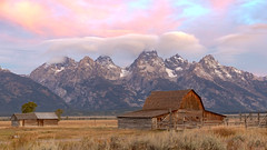 The Grand Tetons with the iconic Moulton barn (sharpshooter2011.com) Tags: moultonbarn grandtetons mountains landscape oldbarns clouds wyoming mormonrow lll landscapephotography