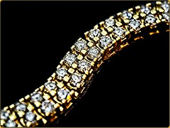 Diamonds in a row on a tennis bracelet (Jack Blackstone) Tags: on1edit macro em1mkii bracelet diamonds tennisbracelet bokeh fantasticmonday sparkle twinkle glitter brilliant inarow leadinglines blackbackground lighting