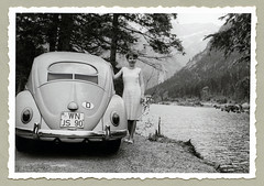"""VW 1200 (Vintage Cars & People) Tags: vintage classic black white """"blackwhite"""" sw photo foto photography automobile car cars motor vw volkswagen vw1200 ovali käfer beetle kever maggiolino fusca coccinelle vehicle antique auto typ1 type1 economicmiracle wirtschaftswunder 1950s fifties dress summerdress lake alps alpi alpen holiday holidays vacances ferien urlaub"""