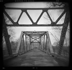 jibboom street bridge. sacramento, ca. 1999. (eyetwist) Tags: eyetwistkevinballuff eyetwist holga square bw blackwhite bridge sacramento jibboom 120s 60mm kodak trix 400 400tx holga120s holga60mmf8 kodaktrix400400tx holgaography toycamera plasticcamera 120 mediumformat lores plasticfantastic vignette ishootfilm scansfromthearchives film analog analogue emulsion ishootkodak tx epsonv750pro filmtagger photoimpact roadside america americana usa road norcal northern atmosphere monochrome black white truss lonely california girders americanriver geometric deserted infrastructure old steel bridgeworks jibboomstreet discoverypark vanishingpoint vanishing point girder beam 1999 plastic toy holgaweek