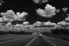 Hyperfocal distance {38/52} (Explored) (therealjoeo) Tags: week382019 startingtuesdayseptember172019 52weeksthe2019edition week38theme sky clouds blackandwhite car street road highway stripe