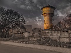 With the tower in the background (wojciechpolewski) Tags: blackandwhite blackwhite blanconegro photos photo streetview schwarzweis blancoenegro urbexexploration streetexploration tower watertower wpolewski poland trees clouds
