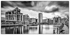 102 Salford Quays (georgestanden) Tags: blackandwhite white black monochrome photography photo photograph desaturated city bw art glass architecture modern buildings manchester cityscape fineart picture salfordquays salford bnw blackandwhitephotography monoart uk longexposure reflection water skyscraper border hdr shipcanal