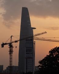 Sunrise in Ho Chi Minh City (billcoo) Tags: travel saigon 1855mm xh1 fujinon vietnam cranes golden helipad skydeck fujifilm observation