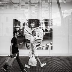 passing by (Gerard Koopen) Tags: spain espana malaga city street streetlife dailylife fashion add woman model people man men walking passingby reflection shopping shoppingbag streetphotography blackandwhite monochrome blackandwhiteonly noir ricoh griii 2019 gerardkoopen gerardkoopenphotography