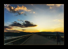 Sunset Strip (* Gemini-6 * (on&off)) Tags: vanishingpoint diagonal wideangle sky clouds bridge architecture sun sunset people river water hudsonriver framed nature fence