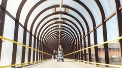 The lifesize elastic band..... (markwilkins64) Tags: londonboroughofbromley london bromley theglades symmetry arches walkway tunnel elasticband humour streetphotography street candid markwilkins