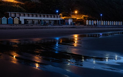 Beach huts before dawn (Julian Chilvers) Tags: night beach building bournemouth beachhut reflection landscape uk dorset pier sunrise sky bournemouthairport sea