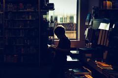 The reader (karolinabat) Tags: bookstore reading indoors lifestyle portrait kid silhouette backlight manga natural light boy