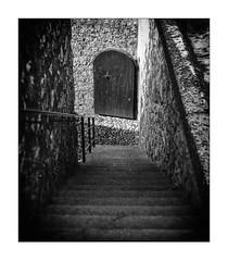 go down: the door is open (Armin Fuchs) Tags: arminfuchs nomansland citadelle sisteron stairway door light shadow diagonal 6x7 niftyfifty anonymousvisitor thomaslistl wolfiwolf jazzinbaggies
