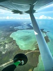 Belize (adamfreeman) Tags: plane belize ocean sea land sky clouds