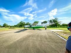 Plane (adamfreeman) Tags: orange walk belize plane runway sugar cane